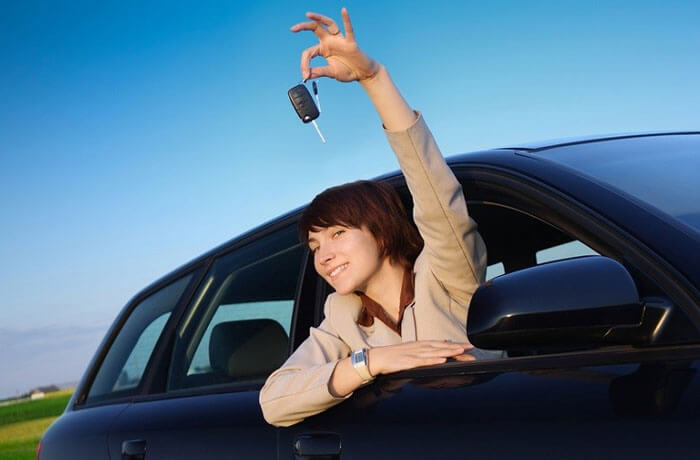 Happy driver holding keys