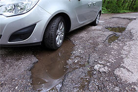 Car stuck in pothole