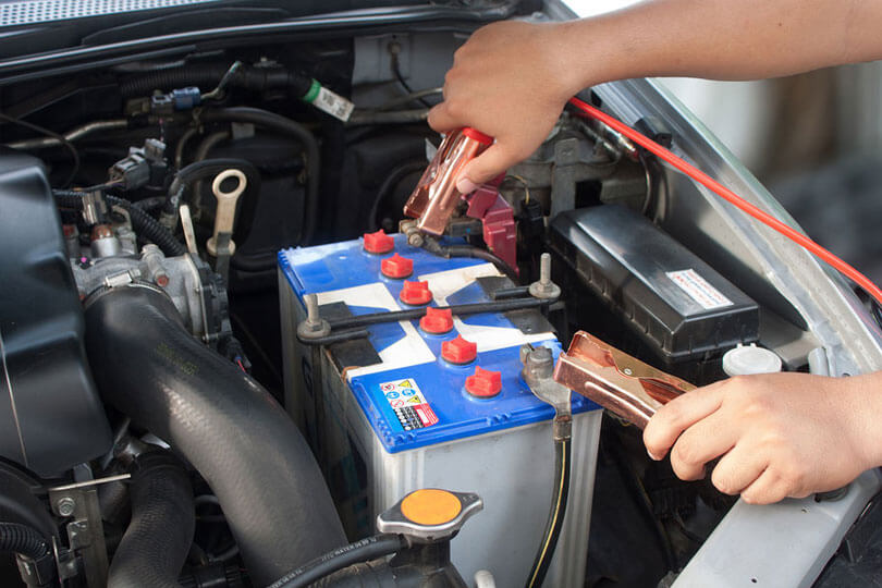 Man jumping a car battery