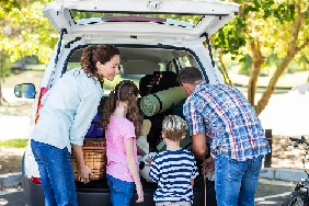 Family packing a car