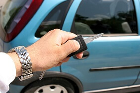 Car key with car in background