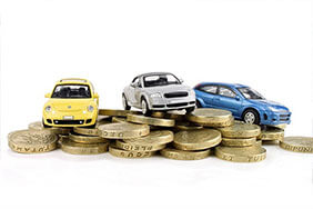 Cars on pound coins - teaser