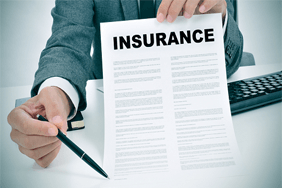 Man in suit with insurance certificate