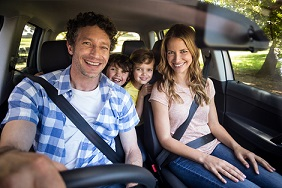Smiling family taking a road trip