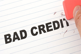 Bad credit written on paper, being erased