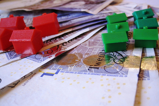 Monopoly houses on money