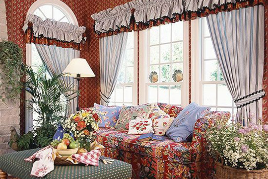 Flora sofa and frilly curtains