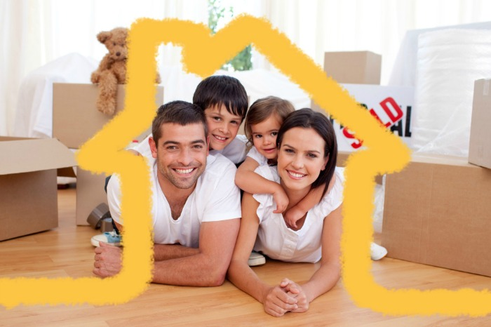 A happy family with a yellow outline of a house