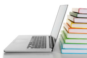 Stack of books and a laptop