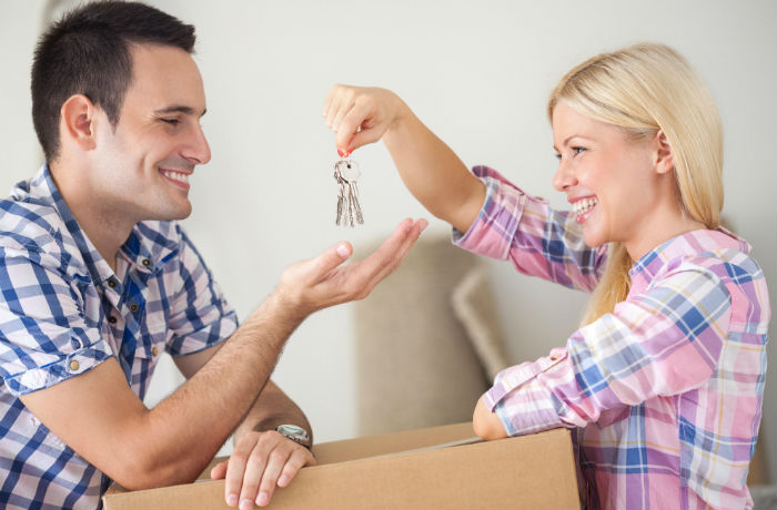 Young couple moving into a house