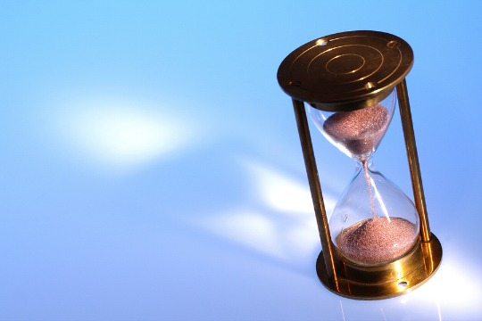 An hourglass on a blue background