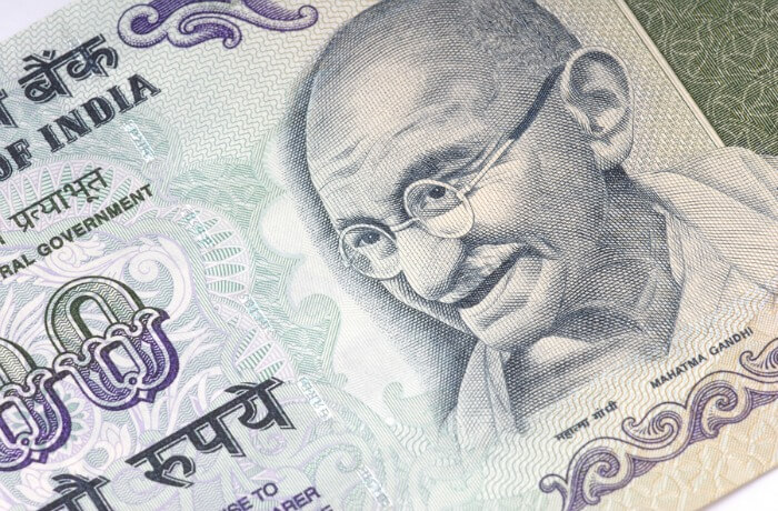 Rupees with Ghandi on