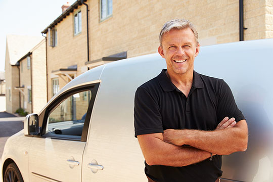 man standing in front of a van