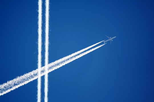 Vapor trails in the sky from an aeroplane