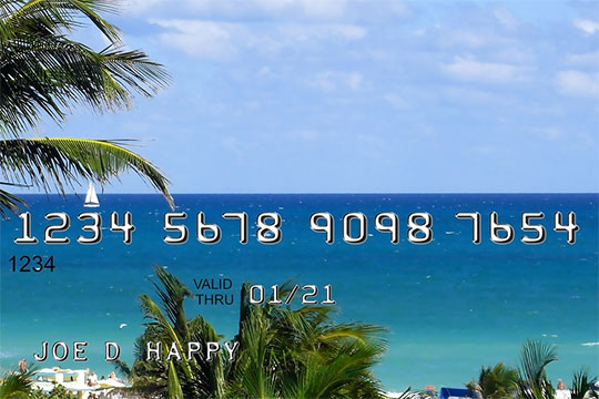 A picture of a credit card with a beach scene on it