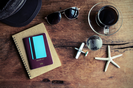 Sunglasses, notebooks and coffee on a table