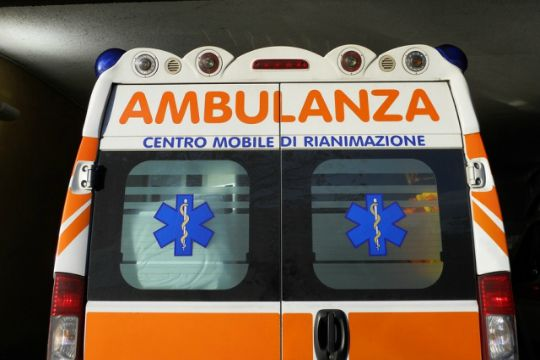 The back of an Italian ambulance at night