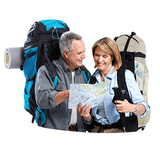 A middle-aged couple with backpacks looking at a map