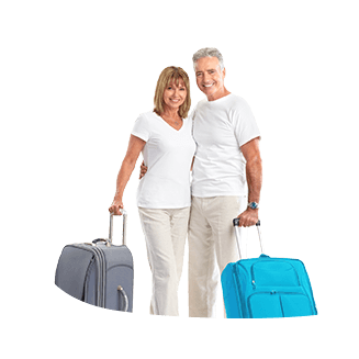 A middle-aged couple with suitcases